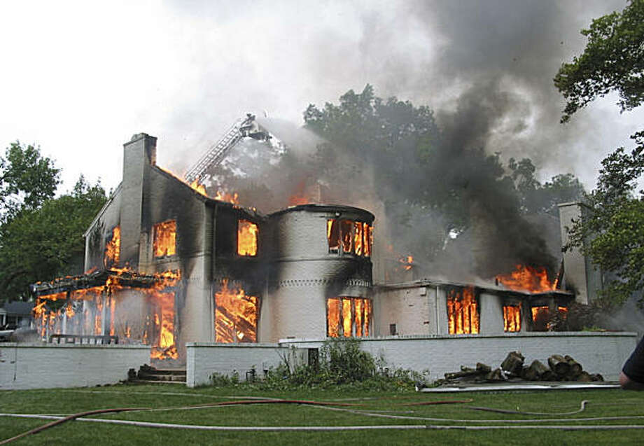 A 2004 file photo provided by The Upper Arlington, Ohio Police Division shows the Upper Arlington home donated by ESPN college football commentator Kirk Herbstreit that was intentionally burned during a training exercise by the local fire department. The former Ohio State football star's claim of a $330,000 tax deduction was rejected a year later. The Internal Revenue Service is trying to stop homeowners from claiming deductions on such donations.  (AP Photo/Columbus Dispatch via Arlington Police Division, File) Photo: Anonymous, AP