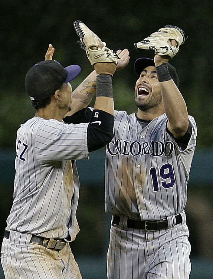 Colorado Rockies Carlos Gonzalez, left, celebrates with teammate Ryan Spilborghs (19) after the Rockies defeated the Philadelphia Phillies 5-4 in Game 2 of the National League division baseball series, Thursday, Oct. 8, 2009, in Philadelphia. (AP Photo/Matt Slocum) Photo: Matt Slocum, AP