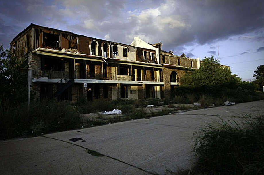 Abandoned apartment buildings in Chalmette, La., that were flooded by Hurricane Katrina in September 2009. The parish population, about 37,000, is roughly half of what it was. The parish of St. Bernard, a quiet, insular suburb just east of New Orleans, has in the end agreed to allow housing for low-income families. But even though it is only a few hundred apartment units, it had to be ordered by a federal judge. The battle over low-income housing has been one of the most bitter that anyone in the middle-class, mostly white parish can remember, one that has stoked issues the region has been grappling with since Hurricane Katrina. (Lee Celano/The New York Times) Photo: Lee Celano, NYT