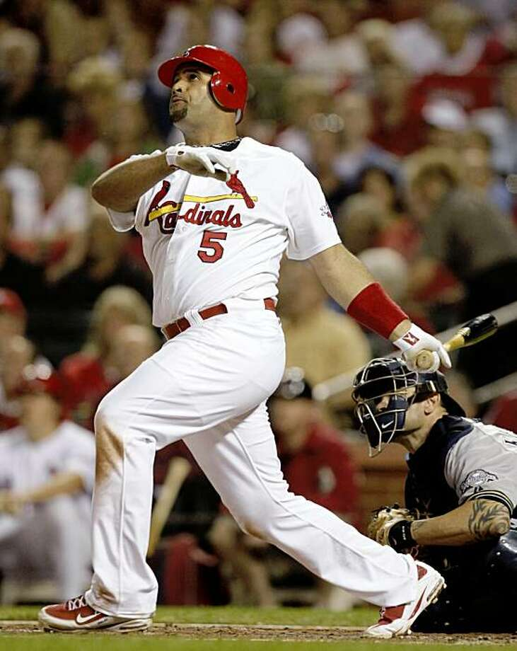 ** ADVANCE FOR WEEKEND EDITIONS, OCT. 3-4 ** FILE - In this Sept. 1, 2009, file photo, St. Louis Cardinals' Albert Pujols hits a home run during a baseball game against the Milwaukee Brewers in St. Louis. The Cardinals enter the playoffs with a deep lineup, one they pieced together through the season as they were basically carried by, guess who, Albert Pujols. (AP Photo/Jeff Roberson, File) Photo: Jeff Roberson, AP