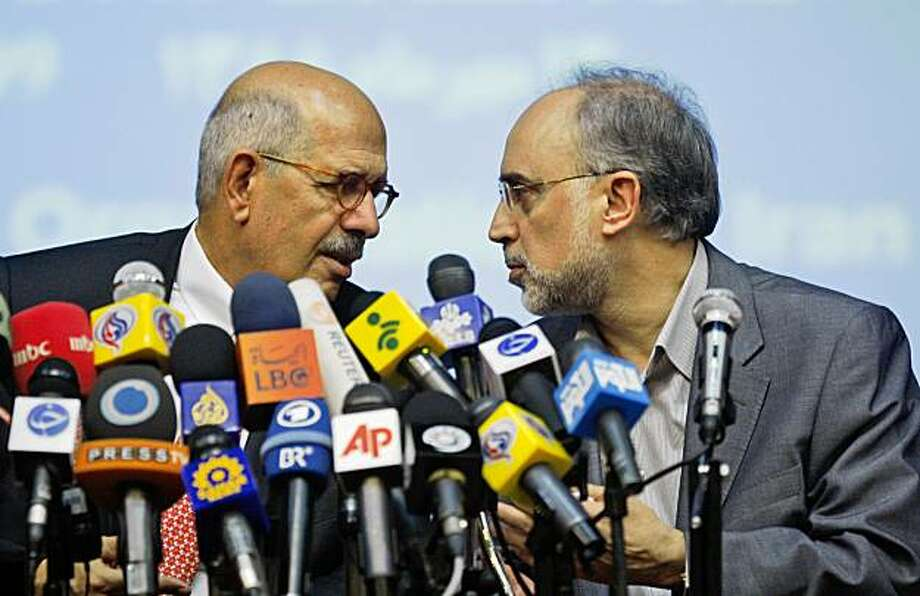 "Head of the International Atomic Energy Agency, Mohamed ElBaradei, left, speaks with the head of Iran's Atomic Energy Organization, Ali Akbar Salehi, during their joint press conference in Tehran, Iran, Sunday, Oct. 4, 2009. The head of the U.N.'s nuclear watchdog on Sunday described a ""shifting of gears"" in the controversy over Iran's nuclear program and said inspectors would visit the country's new uranium processing site Oct. 25. ElBaradei spoke in Tehran following talks with Iranian officials over the recently revealed facility that has caused consternation around to world over the extent and purpose of Iran's nuclear program.  (AP Photo/Vahid Salemi) Photo: Vahid Salemi, AP"