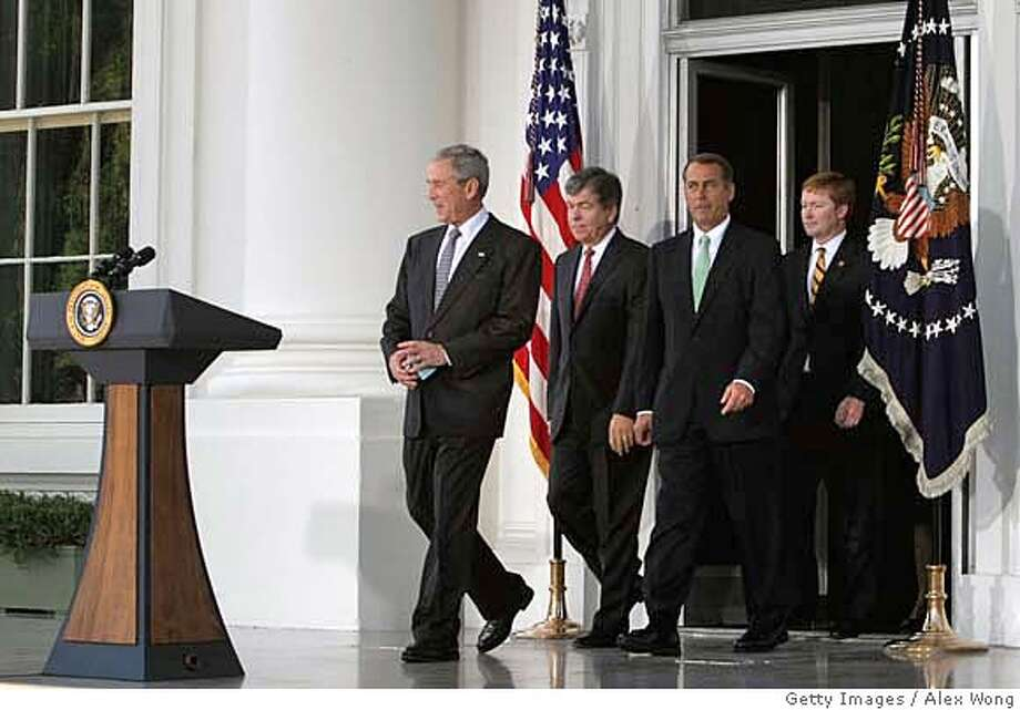 ###Live Caption:WASHINGTON - MAY 07: U.S. President George W. Bush (L) walks towards the podium for a statement with House Minority Leader Rep. John Boehner (R-OH) (3rd L), House Minority Whip Rep. Roy Blunt (R-MO) (2nd L) and Rep. Adam Putnam (R-FL) (R) after meeting with members of the House Republican Conference May 7, 2008 at the North Portico of the White House in Washington, DC. Bush spoke with the Republican lawmakers about various topics including a housing bill, gas prices, Columbia Free Trade and FISA. (Photo by Alex Wong/Getty Images)###Caption History:WASHINGTON - MAY 07: U.S. President George W. Bush (L) walks towards the podium for a statement with House Minority Leader Rep. John Boehner (R-OH) (3rd L), House Minority Whip Rep. Roy Blunt (R-MO) (2nd L) and Rep. Adam Putnam (R-FL) (R) after meeting with members of the House Republican Conference May 7, 2008 at the North Portico of the White House in Washington, DC. Bush spoke with the Republican lawmakers about various topics including a housing bill, gas prices, Columbia Free Trade and FISA. (Photo by Alex Wong/Getty Images)###Notes:Bush Makes Statement After Meeting With House Republicans###Special Instructions: Photo: Alex Wong