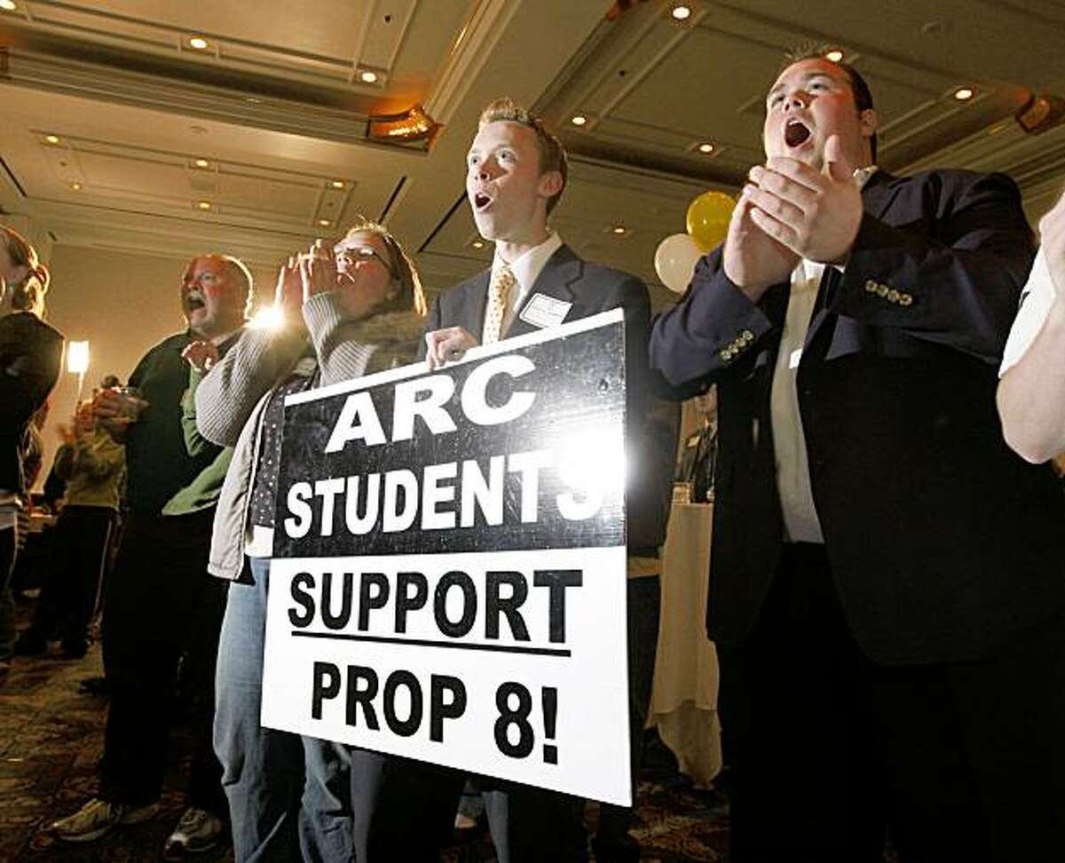 Heather Johnson, left, holding sign, Blaze Jefferson and Jacob Johnson of the American River College Students Association cheer as members of Protect Marriage.com-Yes on Proposition 8 gather at the Sacramento Hyatt Hotel in Sacramento, Calif., on Tuesday, Nov. 4, 2008 to wait returns from the 2008 Presidential election.