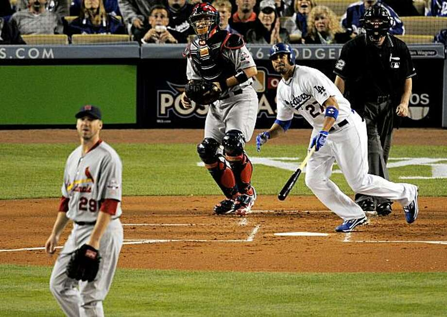 Los Angeles Dodgers' Matt Kemp, right, hits a two-run home run as St. Louis Cardinals catcher Yadier Molina, center, and starting pitcher Chris Carpenter look on during the first inning of Game 1 of the National League division baseball series, Wednesday, Oct. 7, 2009, in Los Angeles. (AP Photo/Mark J. Terrill) Photo: Mark J. Terrill, AP