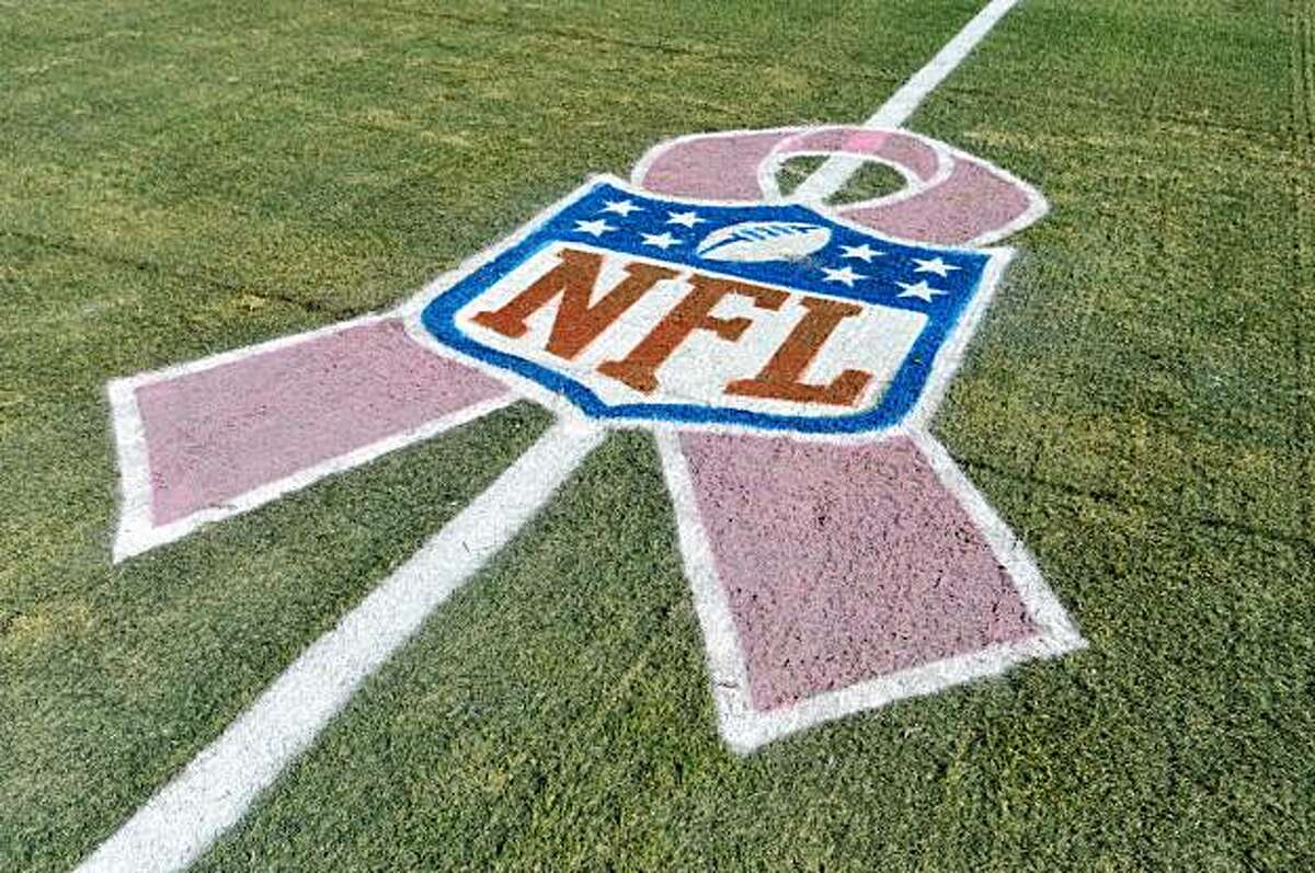 LANDOVER, MD - OCTOBER 4: The NFL logo showcases Breast Cancer Awareness month before the game between the Washington Redskins and the Tampa Bay Buccaneers at FedExField on October 4, 2009 in Landover, Maryland. Many players and officials in the NFL wore pink as part of breast cancer awareness month. The Redskins defeated the Buccaneers 16-13. (Photo by Larry French/Getty Images)