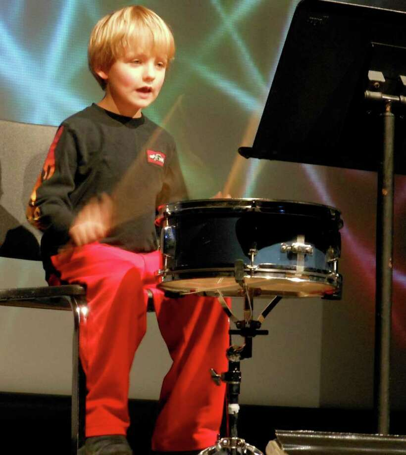 Cooper Osinski rocks out on the drums Friday at the Osborn Hill School Variety Show. Photo: Mike Lauterborn / Fairfield Citizen contributed