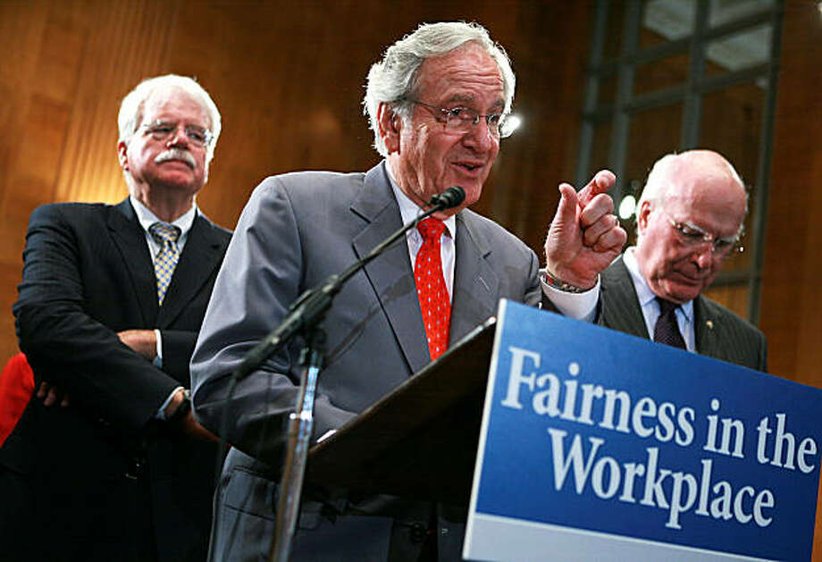 WASHINGTON - OCTOBER 06:  U.S. Sen. Tom Harkin (C) (D-IA) speaks as Rep. George Miller (D-CA) (L), and Sen. Patrick Leahy (D-VT) listen during a news conference on Capitol Hill October 6, 2009 in Washington, DC. Legislation was introduced by Harkin, Leahy and Miller to protect older workers from discrimination.  (Photo by Alex Wong/Getty Images) Photo: Alex Wong, Getty Images