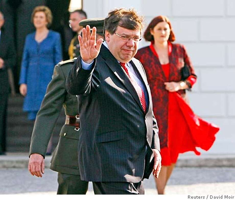 s newly elected Prime Minister Brian Cowen waves to photographers as he leaves the President's residence in Dublin May 7, 2008. Cowen was today appointed the new prime minister by President of Mary McAleese after Bertie Ahern stepped down. REUTERS/David Moir (IRELAND) Photo: DAVID MOIR