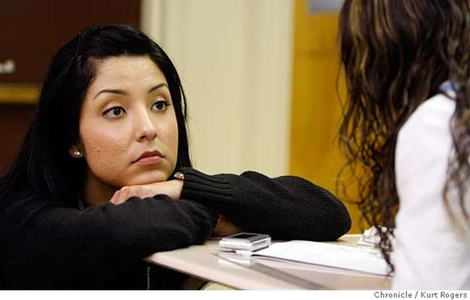 ###Live Caption:Nidya Baez leans on Maribel Mata's desk as she listens to another student ask a question. Nidya is substitute teaching a geometry class at Fremont High in Oakland on Friday, Feb .29, 2008. Photo By Kurt Rogers / San Francisco Chronicle###Caption History:Nidya Baez leans on Maribel Mata�s desk as she listens to another student ask a question.  Nidya is substitute teaching Geometry class at Fremont High in Oakland on Friday Feb 29,2008. She is writing her story for the Chronicle on the need for retooling schools. Photo By Kurt Rogers / San Francisco Chronicle###Notes:Nidya Baez (cq) 22 a teacher at Fremont High in Oakland . Maribel Mata (cq)  She is writing her story for the Chronicle on the need for retooling schools.###Special Instructions:MANDATORY CREDIT FOR PHOTOG AND SAN FRANCISCO CHRONICLE/NO SALES-MAGS OUT Photo: Kurt Rogers