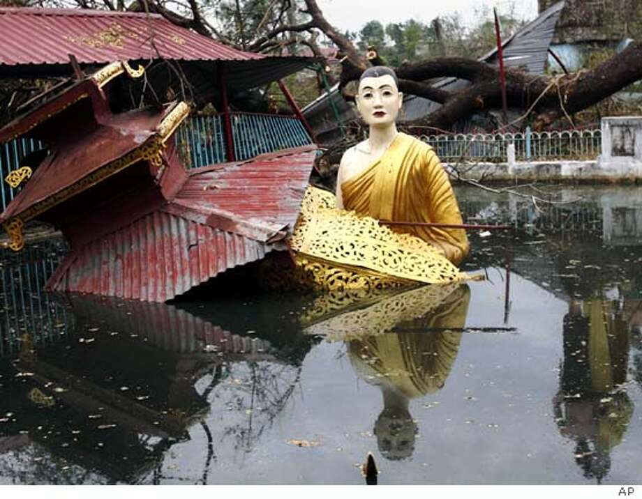 A large statue of Buddha sits in water at a temple that was heavily damaged by last week's destructive cyclone Nargis, in the outskirts of Yangon, Myanmar, on Sunday May 11, 2008. (AP Photo)