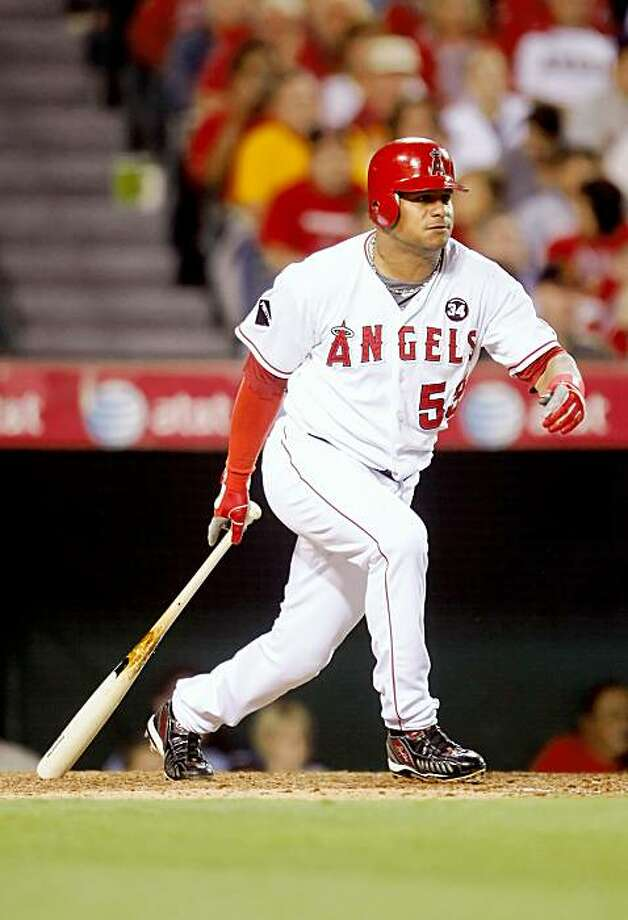 ANAHEIM, CA - SEPTEMBER 29:  Bobby Abreu #53 of the Los Angeles Angels of Anaheim hits an infield single in the fourth inning against the Texas Rangers at Angel Stadium on September 29, 2009 in Anaheim, California.  (Photo by Jeff Gross/Getty Images) Photo: Jeff Gross, Getty Images
