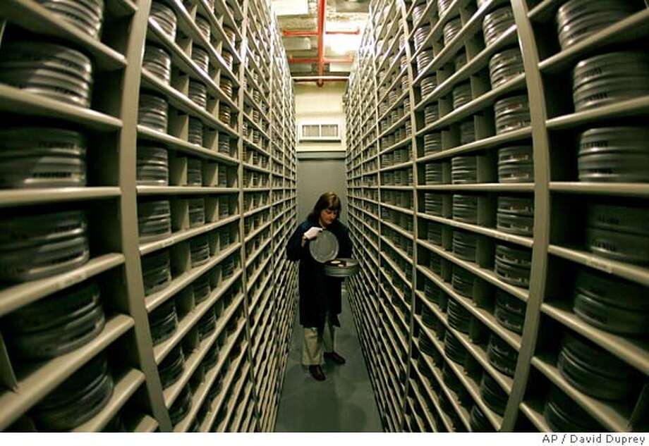 ###Live Caption:Deborah Stoiber looks for a movie inside the nitrate film vault at the George Eastman House Louis B. Mayer Conservation Center in Chili, N.Y., Thursday April 24, 2008. Thousands of pre-1951 movies captured on volatile nitrate film are kept in frigid, low-humidity vaults in a modest cinderblock building owned by the George Eastman House museum on the piney outskirts of Rochester. (AP Photo/David Duprey)###Caption History:Deborah Stoiber looks for a movie inside the nitrate film vault at the George Eastman House Louis B. Mayer Conservation Center in Chili, N.Y., Thursday April 24, 2008. Thousands of pre-1951 movies captured on volatile nitrate film are kept in frigid, low-humidity vaults in a modest cinderblock building owned by the George Eastman House museum on the piney outskirts of Rochester. (AP Photo/David Duprey)###Notes:###Special Instructions: Photo: David Duprey