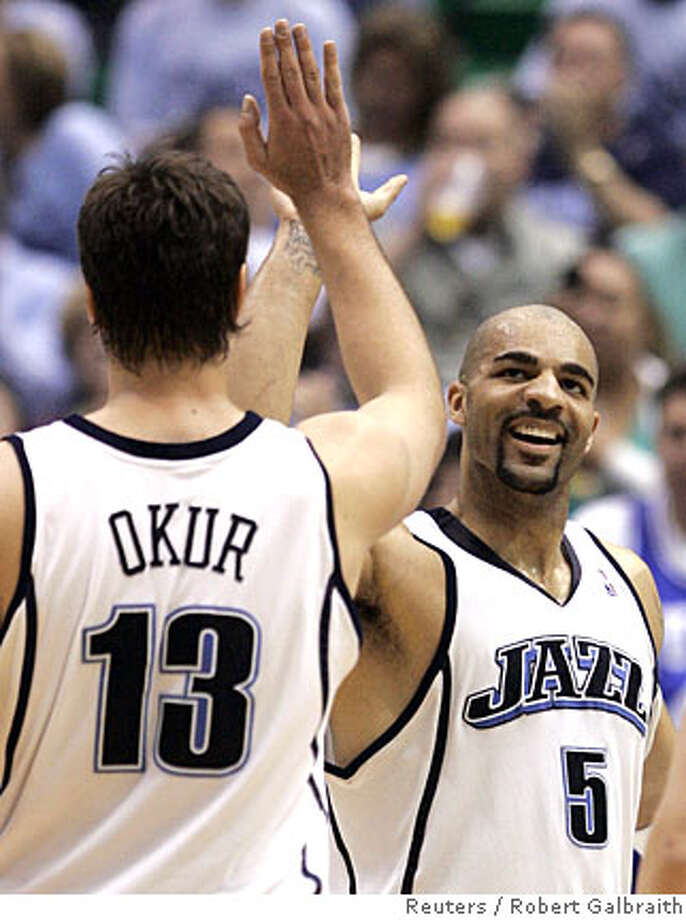 Utah Jazz Carlos Boozer (R) high-fives teammate Mehmet Okur after scoring on the Los Angeles Lakers during Game 3 of their NBA Western Conference semi-final basketball series in Salt Lake City, Utah May 9, 2008. REUTERS/Robert Galbraith (UNITED STATES)  Ran on: 05-10-2008  Carlos Boozer high-fives Mehmet Okur after scoring 27 points and getting 20 rebounds to lead the Jazz over the Lakers to cut their series deficit to 2-1.  Ran on: 05-10-2008  Carlos Boozer high-fives Mehmet Okur after scoring 27 points and getting 20 rebounds to lead the Jazz over the Lakers to cut their series deficit to 2-1.  Ran on: 05-10-2008 Photo: ROBERT GALBRAITH