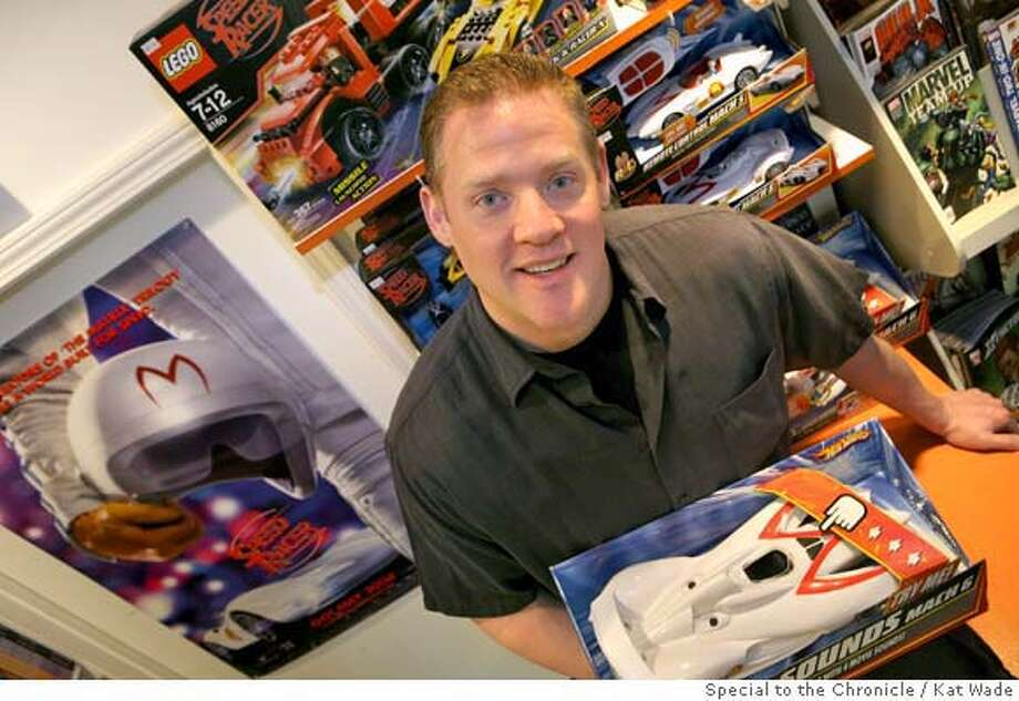 Stephen Tarantino, owner of The Collectors Cave Toy Store in San Francisco, Calif. poses with his display of Speed Racer toys and poster in his Union Street store on Friday, May 2, 2008.  Photo by Kat Wade / Special to the Chronicle Ran on: 05-07-2008  Clockwise, from left: Underdog, Don Adams as Maxwell Smart and chipmunk Alvin. Photo: Kat Wade