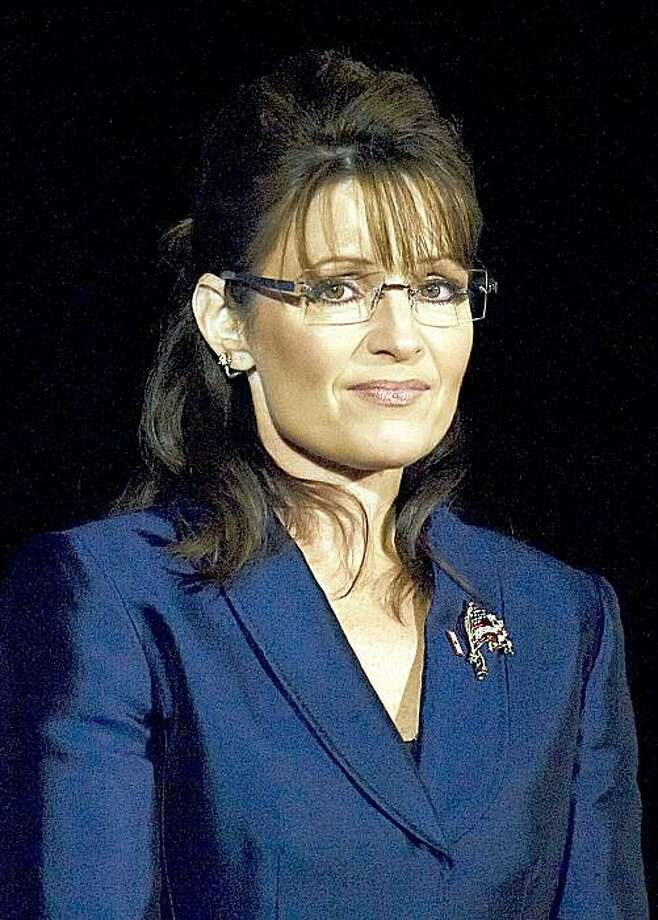 "(FILES) Former US Vice presidential candidate Sarah Palin listens as Republican presidential candidate John McCain addresses supporters during his election night rally at the Arizona Biltmore Resort & Spa in this November 4, 2008 file photo in Phoenix, Arizona.  Sarah Palin's memoirs will be released November 17 under the title ""Going Rogue: An American Life,"" her publisher said September 29, 2009. Publishing house HarperCollins said that the ex-Alaska governor finished her book weeks earlier than anticipated, allowing it to get into bookstores ahead of the Christmas holiday shopping season. The book originally was scheduled for a spring 2010 publication date, HarperCollins said in a statement. AFP PHOTO/Jim WATSON/FILES (Photo credit should read JIM WATSON/AFP/Getty Images) Photo: Jim Watson, AFP/Getty Images"