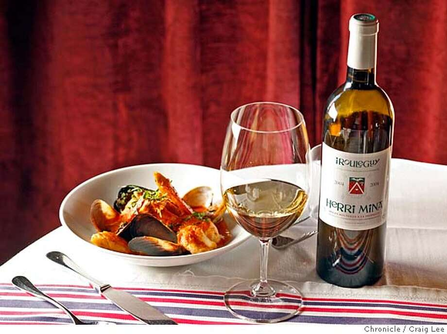 ###Live Caption:A glass of Herri Mina Irouleguy wine, next to the bottle, with a dish of seafood stew at Piperade restaurant in San Francisco on May 6, 2008.  Photo by Craig Lee / The San Francisco Chronicle###Caption History:A glass of Herri Mina Irouleguy wine, next to the bottle, with a dish of seafood stew at Piperade restaurant in San Francisco on May 6, 2008.  Photo by Craig Lee / The San Francisco Chronicle###Notes:Piperade restaurant 415-391-2555  Craig Lee 415-218-8597 clee@sfchronicle.com###Special Instructions:MANDATORY CREDIT FOR PHOTOG AND SF CHRONICLE/NO SALES-MAGS OUT Photo: Photo By Craig Lee