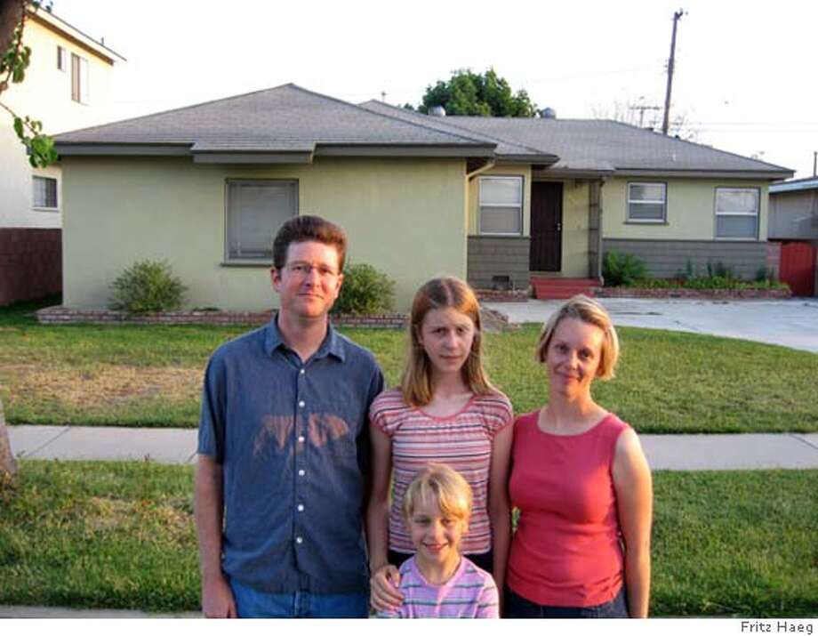 "###Live Caption:""Edible Estates Regional Prototype Garden #2: lakewood, California, 2006"" front lawn before with Foti family (photo by Fritz Haeg) and after (photo by Taidgh O'Neill###Caption History:""Edible Estates Regional Prototype Garden #2: lakewood, California, 2006"" front lawn before with Foti family (photo by Fritz Haeg) and after (photo by Taidgh O'Neill###Notes:###Special Instructions: Photo: Fritz Haeg And Taidgh O'Neill"
