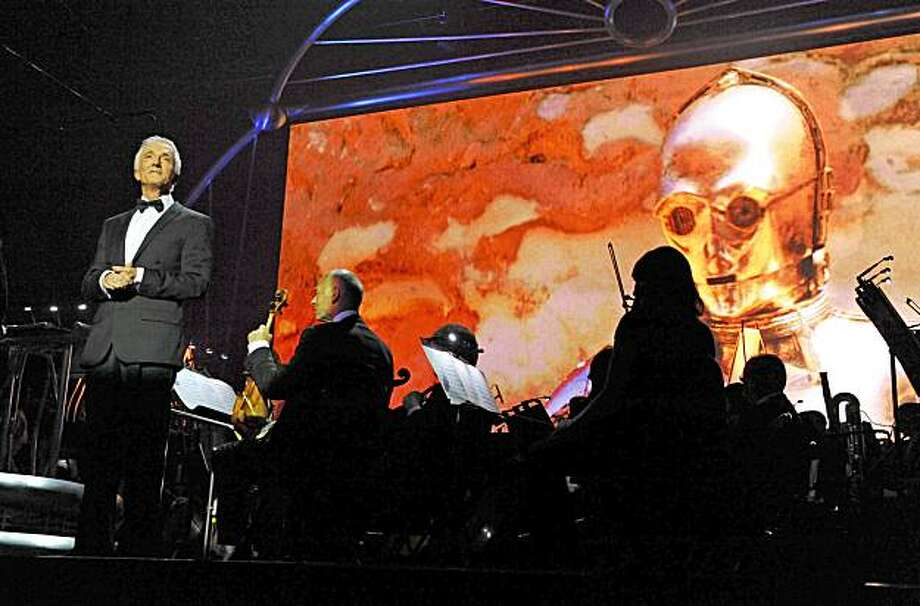 Anthony Daniels narrates a clip of himself as C-3PO in Star Wars in Concert. Photo: Courtesy Lucasfilm Ltd.