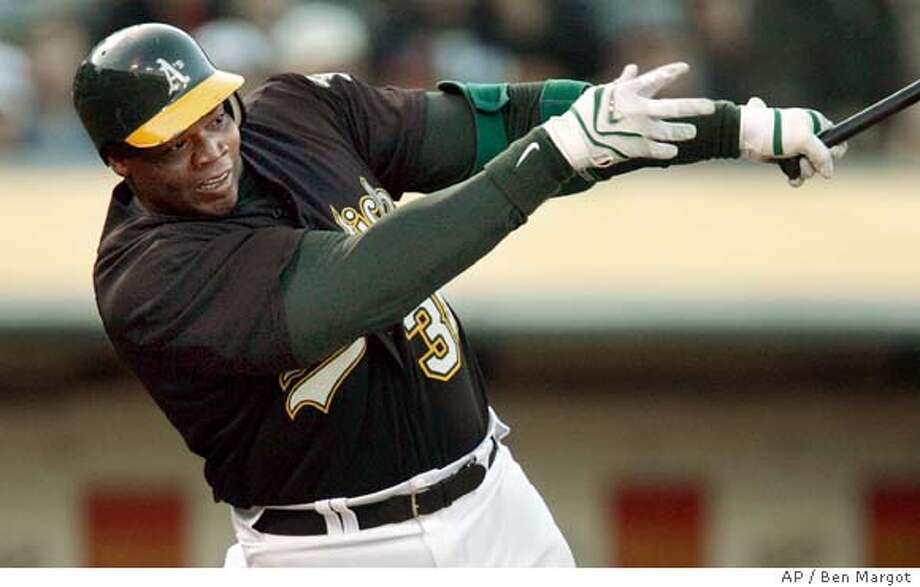 Oakland Athletics' Frank Thomas follows through on a single off Baltimore Orioles' Brian Burres during the first inning of a baseball game Tuesday, May 6, 2008, in Oakland, Calif. (AP Photo/Ben Margot) Photo: Ben Margot