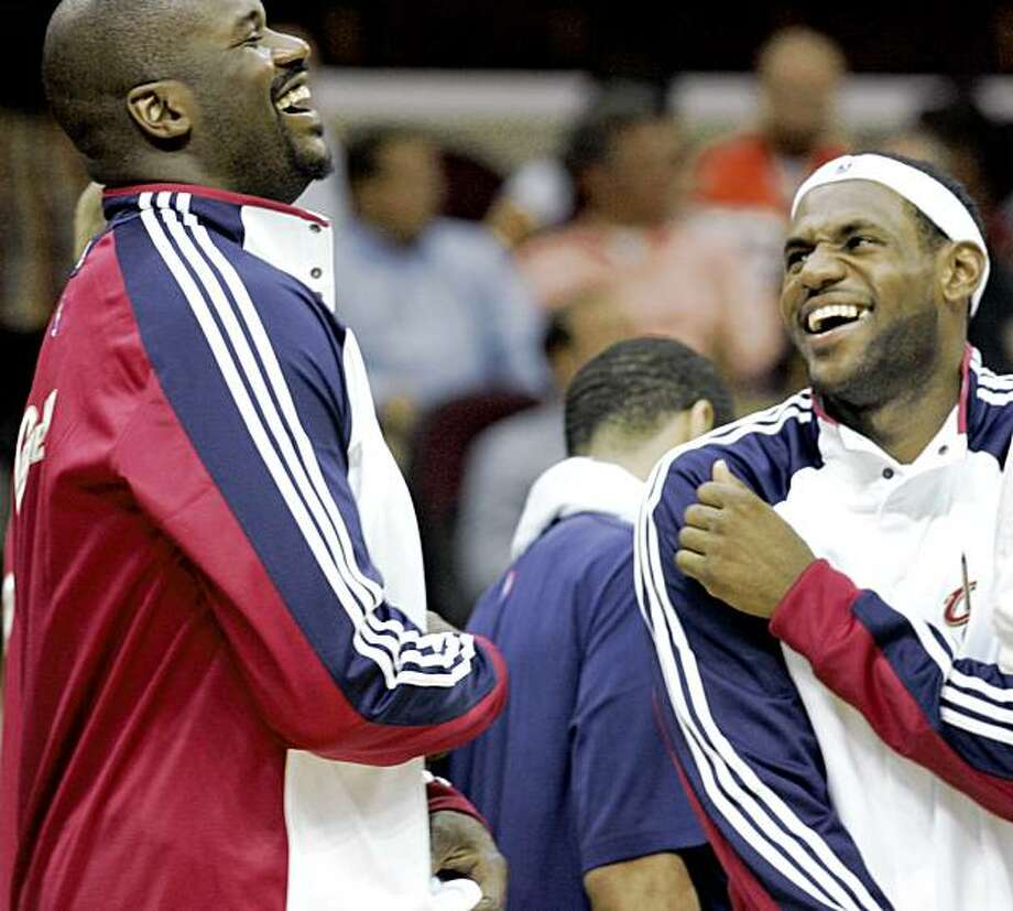 Cleveland Cavaliers' Shaquille O'Neal, left, and LeBron James laugh in the fourth quarter of a preseason NBA basketball game against the Charlotte Bobcats, Tuesday, Oct. 6, 2009, in Cleveland. The Cavaliers won 92-87. (AP Photo/Tony Dejak) Photo: Tony Dejak, AP