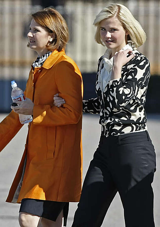 Elizabeth Smart (R), walks with her mother Louis Smart (L) after Elizabeth Smart testified, for the first time, in a competency hearing for her kidnapper Brian David Mitchell on October 1, 2009 in Salt Lake City, Utah. Smart was kidnapped in 2002 by Mitchell, held for captive for nine months and reunited then with her family on March 12, 2003 after police received tips from a store miles from her home   (Photo by George Frey/Getty Images) Photo: George Frey, Getty Images