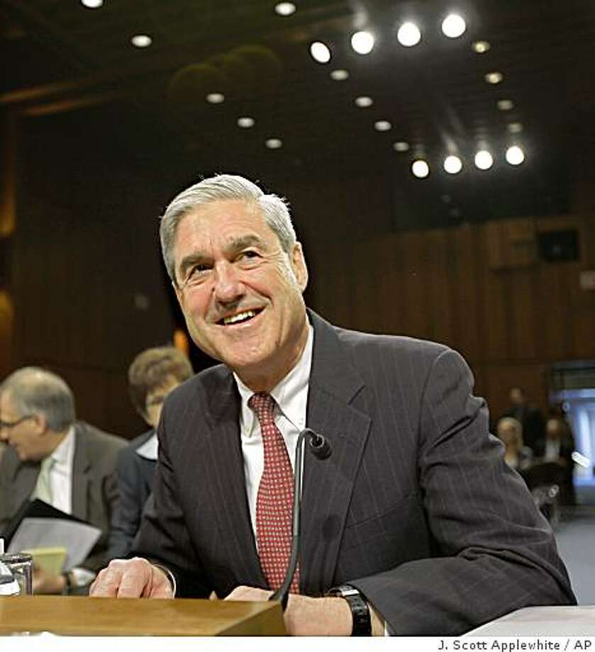 FBI Director Robert Mueller prepares to testify on Capitol Hill in Washington, Wednesday, March 25, 2009, before a Senate Judiciary Committee hearing regarding the FBI.  (AP Photo/J.  Scott Applewhite) Photo: J. Scott Applewhite, AP