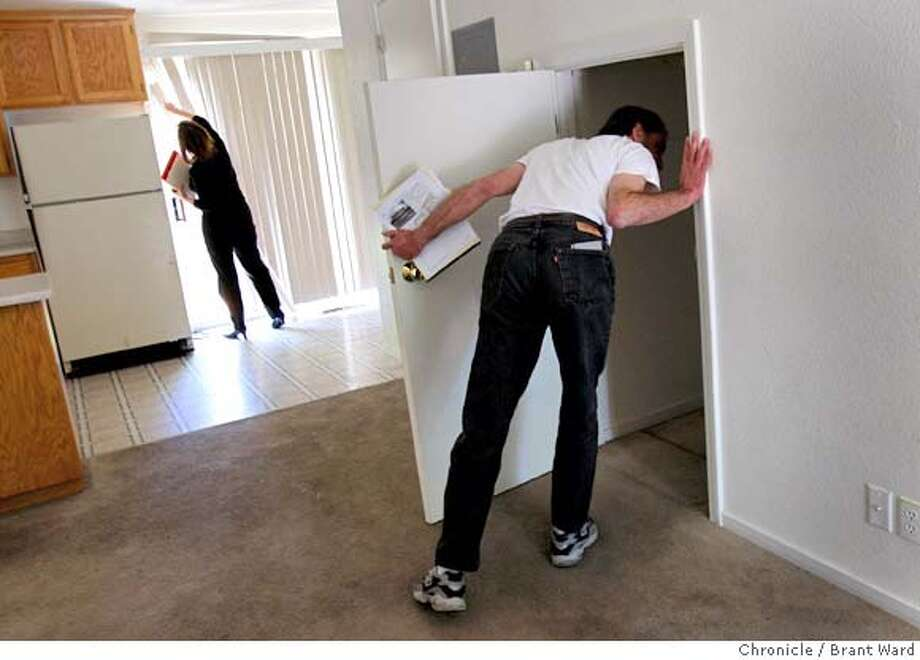 Realtor Tammra Borrall, left, and Daniel Shiner investigate a home that is being foreclosed in Santa Rosa. Some investors and first-time home buyers are jumping into the market to take advantage of bargains. Daniel Shiner is buying duplexes in Santa Rosa, CA Wednesday, April 30, 2008.Photo by Brant Ward / The Chronicle  Ran on: 05-09-2008  Dan Shiner and Realtor Tammra Borrall investigate a home facing foreclosure in Santa Rosa.  Ran on: 05-09-2008 Photo: Brant Ward
