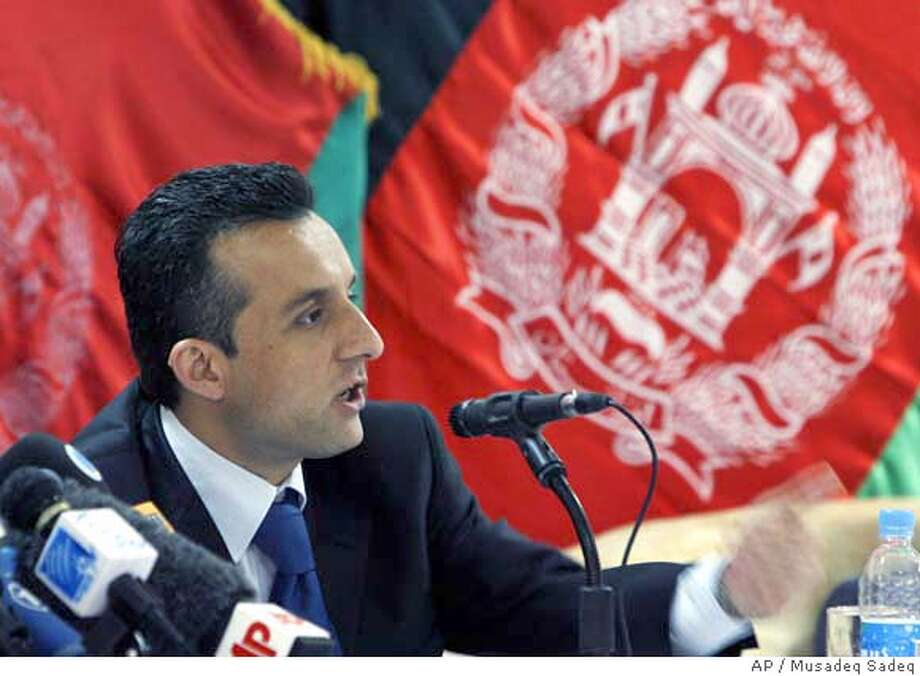 ###Live Caption:Afghanistan's intelligence chief Amrullah Saleh speaks during a joint press conference with Interior Minister Zarar Ahmad Moqbel and Defense Minister Abdul Rahim Wardak, unseen, in Kabul, Afghanistan, on Sunday May 4, 2008, regarding last Sundays assassination plot against Afghan President Hamid Karzai. Top officials say they have arrested two Afghan government employees for alleged involvement in last week's plot to kill President Hamid Karzai. (AP Photo/Musadeq Sadeq)###Caption History:Afghanistan's intelligence chief Amrullah Saleh speaks during a joint press conference with Interior Minister Zarar Ahmad Moqbel and Defense Minister Abdul Rahim Wardak, unseen, in Kabul, Afghanistan, on Sunday May 4, 2008, regarding last Sundays assassination plot against Afghan President Hamid Karzai. Top officials say they have arrested two Afghan government employees for alleged involvement in last week's plot to kill President Hamid Karzai. (AP Photo/Musadeq Sadeq)###Notes:###Special Instructions:WITH THE STORY OF AFGHANISTAN KARZAI PLOT Photo: Musadeq Sadeq
