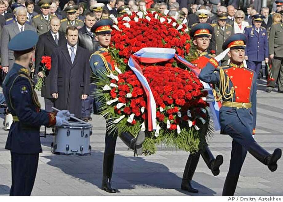 ###Live Caption:From left: State Duma speaker Boris Gryzlov, former president Vladimir Putin, Russian President Dmitry Medvedev take part in a wreath laying ceremony at the Tomb of Unknown Soldier on the eve of the Victory Day, which is celebrated on May 9 in Russia, in Moscow, Thursday, May 8, 2008. (AP Photo/RIA Novosti,Dmitry Astakhov, pool)###Caption History:From left: State Duma speaker Boris Gryzlov, former president Vladimir Putin, Russian President Dmitry Medvedev take part in a wreath laying ceremony at the Tomb of Unknown Soldier on the eve of the Victory Day, which is celebrated on May 9 in Russia, in Moscow, Thursday, May 8, 2008. (AP Photo/RIA Novosti,Dmitry Astakhov, pool)###Notes:Dmitry Medvedev, Boris Gryzlov, Vladimir Putin, Dmitry Medvedev###Special Instructions: Photo: DMITRY ASTAKHOV