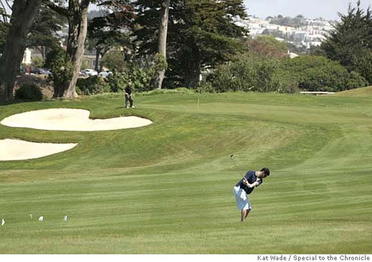 ###Live Caption:From left, Felix Vulis and Andrew Kantarzhi finish up their game on the 18th hole at the Harding Park Golf Course in San Francisco, Calif. on Monday, May 5, 2008. Photo by Kat Wade###Caption History:From left, Felix Vulis and Andrew Kantarzhi finish up their game on the 18th hole at the Harding Park Golf Course in San Francisco, Calif. on Monday, May 5, 2008. Photo by Kat Wade###Notes:Felix Vulis and Andrew Kantarzhi###Special Instructions:Mandatory Credit for photographer /No Sales - mags out