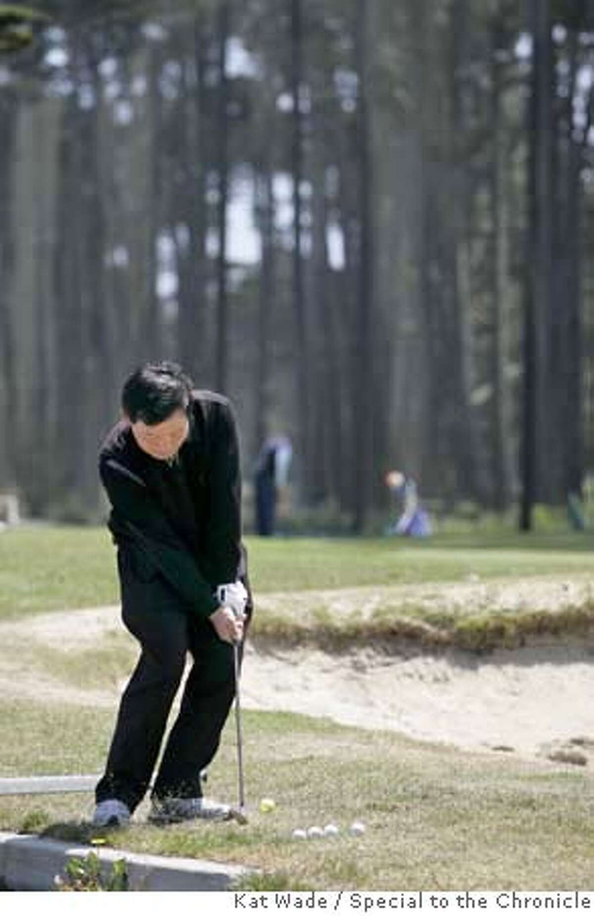 ###Live Caption:Visitor Tae Hui Chong from Korea practices getting over a sand trap18th hole at the Harding Park Golf Course in San Francisco, Calif. on Monday, May 5, 2008. Photo by Kat Wade###Caption History:Visitor Tae Hui Chong from Korea practices getting over a sand trap18th hole at the Harding Park Golf Course in San Francisco, Calif. on Monday, May 5, 2008. Photo by Kat Wade###Notes:###Special Instructions:Mandatory Credit for photographer /No Sales - mags out