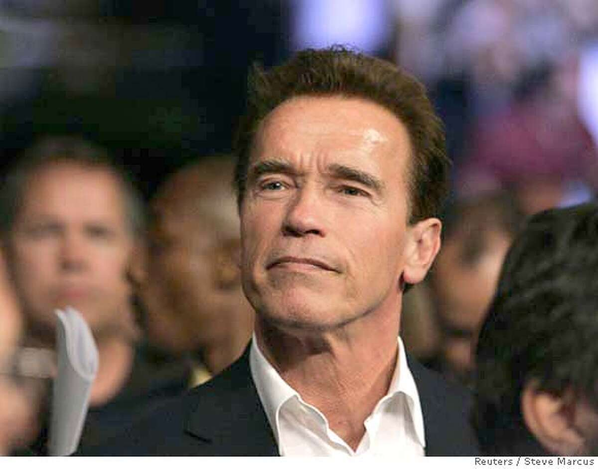 ###Live Caption:California Governor Arnold Schwarzenegger looks on before the Bernard Hopkins versus Joe Calzaghe light-heavyweight boxing fight at the Thomas & Mack Center in Las Vegas, Nevada April 19, 2008. REUTERS/Steve Marcus (UNITED STATES)###Caption History:California Governor Arnold Schwarzenegger looks on before the Bernard Hopkins versus Joe Calzaghe light-heavyweight boxing fight at the Thomas & Mack Center in Las Vegas, Nevada April 19, 2008. REUTERS/Steve Marcus (UNITED STATES)###Notes:California Governor Schwarzenegger looks on before the Hopkins versus Calzaghe light-heavyweight boxing fight in Las Vegas###Special Instructions: