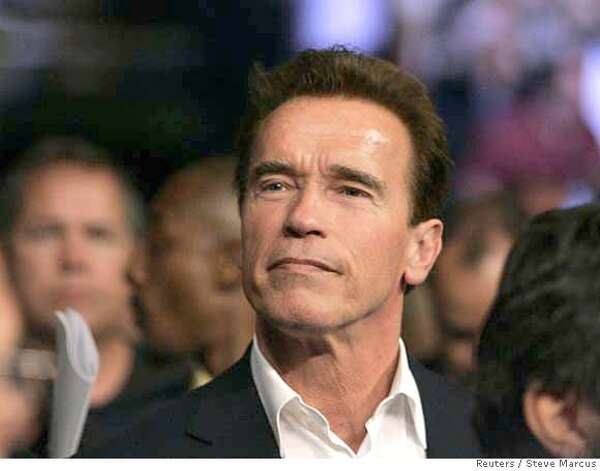 ###Live Caption:California Governor Arnold Schwarzenegger looks on before the Bernard Hopkins versus Joe Calzaghe light-heavyweight boxing fight at the Thomas & Mack Center in Las Vegas, Nevada April 19, 2008. REUTERS/Steve Marcus (UNITED STATES)###Caption History:California Governor Arnold Schwarzenegger looks on before the Bernard Hopkins versus Joe Calzaghe light-heavyweight boxing fight at the Thomas & Mack Center in Las Vegas, Nevada April 19, 2008. REUTERS/Steve Marcus (UNITED STATES)###Notes:California Governor Schwarzenegger looks on before the Hopkins versus Calzaghe light-heavyweight boxing fight in Las Vegas###Special Instructions: Photo: STEVE MARCUS