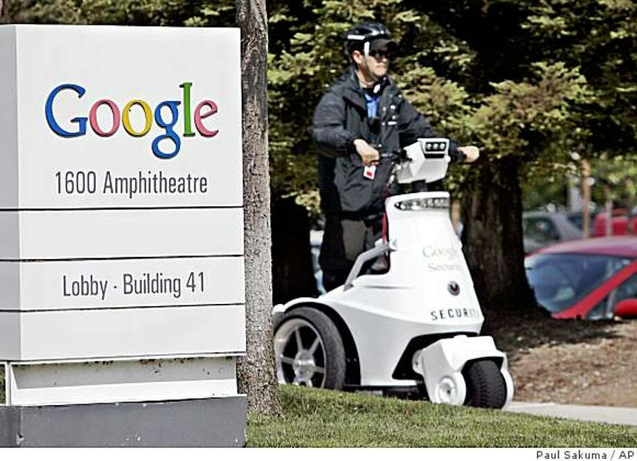 A Google security guard rides a vehicle in front of Google headquarters in Mountain View, Calif., Wednesday, May 7, 2008. It's hard to believe that just two months ago people were starting to openly wonder if the tide had finally turned against Google. Now, on the eve of its annual shareholders meeting, the online search leader looks stronger than ever. (AP Photo/Paul Sakuma) Photo: Paul Sakuma, AP
