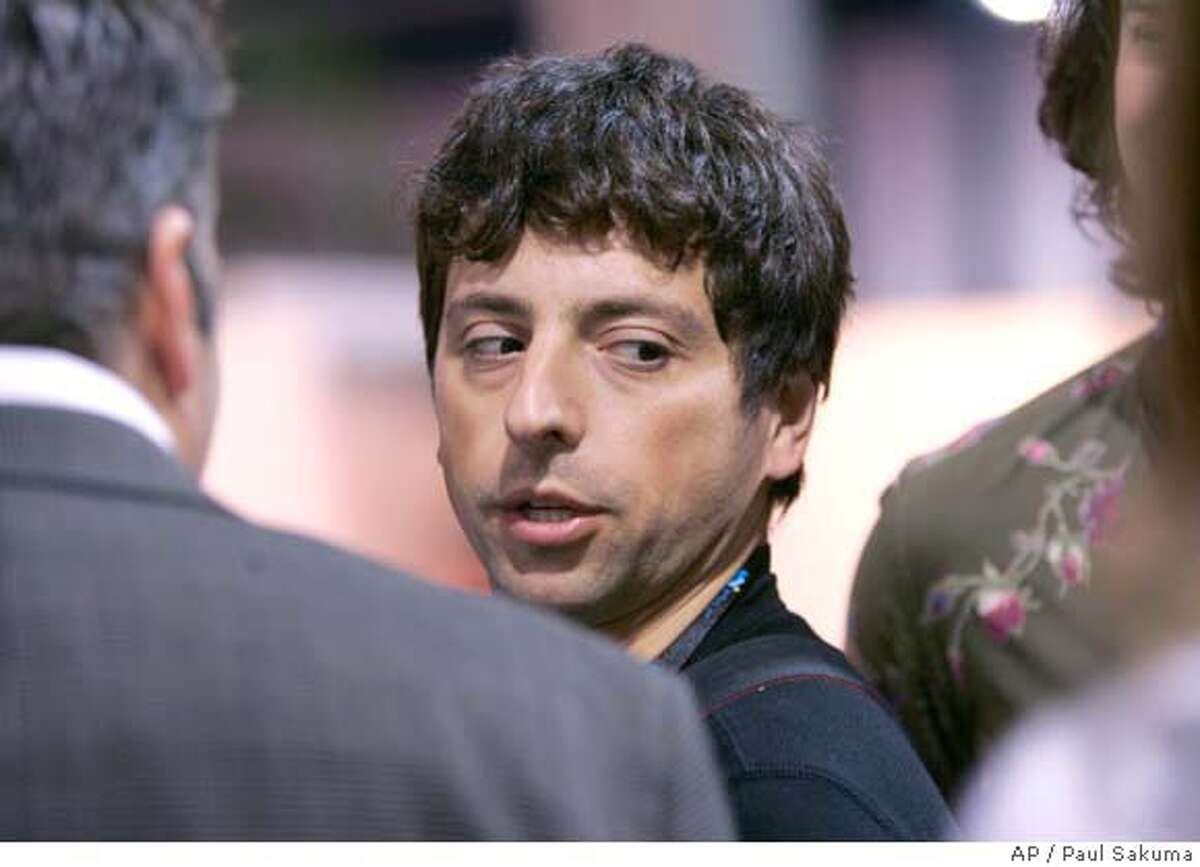 **FILE** Google co-founder Sergey Brin walks the exhibit hall at the Consumer Electronics Show (CES) in Las Vegas in this Jan. 9, 2008 file photo. Google is expected to release quarterly earnings after the market closes Thursday, Jan. 31, 2008. (AP Photo/Paul Sakuma, file) Ran on: 02-01-2008 Google co-founder Sergey Brin is sanguine about the downturn in Googles share prices. Ran on: 05-09-2008 Sergey Brin says Googles moves were designed to help Yahoo remain independent. Ran on: 05-09-2008