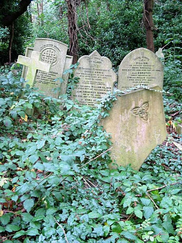 TRAVEL LONDON -- In England where graves aren't reused or disturbed, Highgate Cemetery offers a walk through names that made history in England and the world. The western part of the cemetery includes grave of Michael Faraday; the eastern, Karl Marx and Mary Ann Evans (George Eliot).  Ran on: 05-07-2006 Photo: Mary Ellen Botter, Dallas Morning News