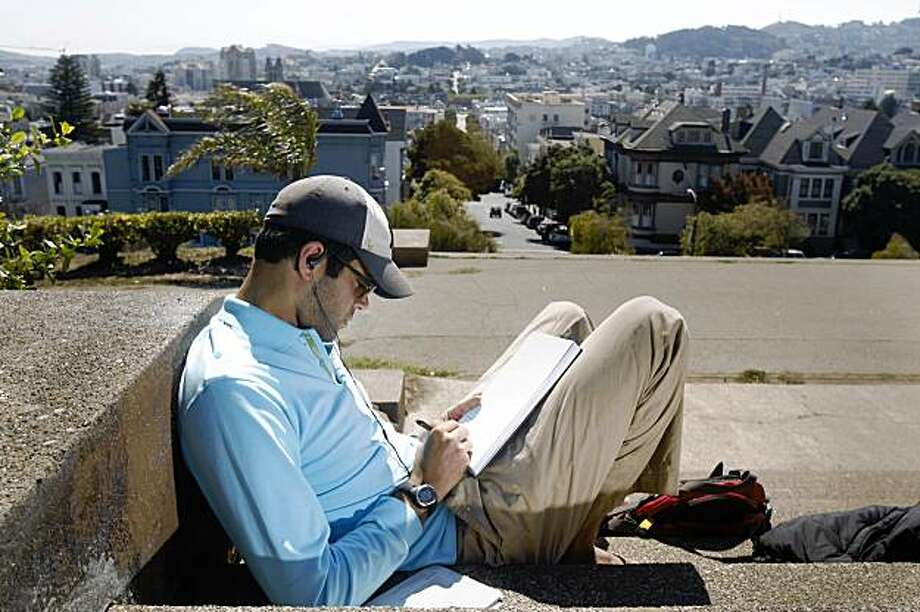 Maz Naba of San Francisco enjoys the sun  on his day off while sitting atop the staircase at Clay at Pierce Streets in San Francisco, Calif. on Monday, September 21, 2009. Photo: Lea Suzuki, The Chronicle