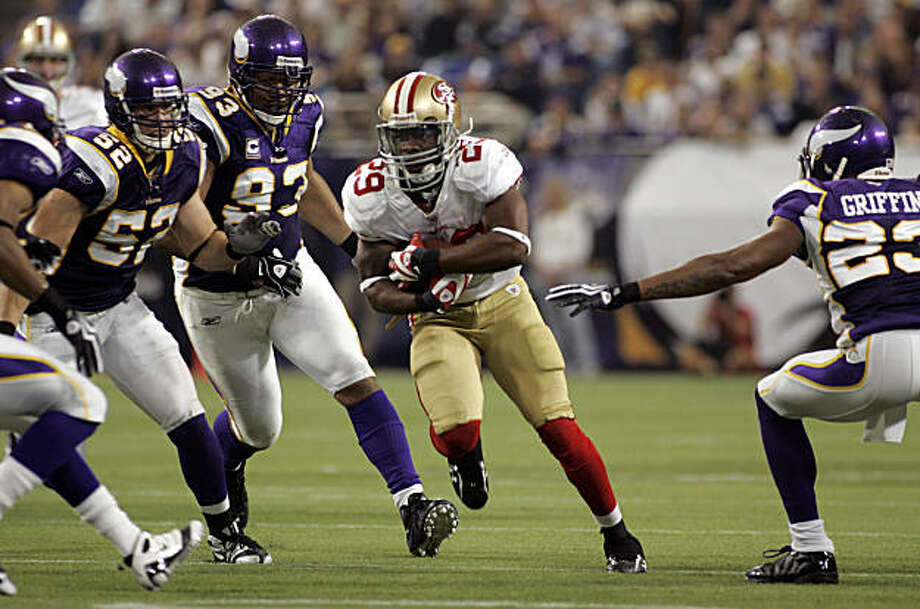 San Francisco 49ers' running back Glen Coffee, center, is pursued by Minnesota Vikings' Chad Greenway (52), Kevin Williams (93) and Cedric Griffin (23) on a 21-yard run during the second half of an NFL football game, Sunday, Sept. 27, 2009, in Minneapolis. Minnesota won 27-24. (AP Photo/Paul Battaglia) Photo: Paul Battaglia, AP
