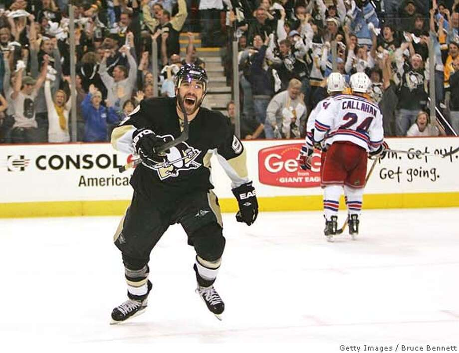 ###Live Caption:PITTSBURGH - MAY 04: Pascal Dupuis #9 of the Pittsburgh Penguins celebrates the game winning goal against the New York Rangers during game five of the Eastern Conference Semifinals of the 2008 NHL Stanley Cup Playoffs on May 4, 2008 at the Mellon Arena in Pittsburgh, Pennsylvania. (Photo by Bruce Bennett/Getty Images)###Caption History:PITTSBURGH - MAY 04: Pascal Dupuis #9 of the Pittsburgh Penguins celebrates the game winning goal against the New York Rangers during game five of the Eastern Conference Semifinals of the 2008 NHL Stanley Cup Playoffs on May 4, 2008 at the Mellon Arena in Pittsburgh, Pennsylvania. (Photo by Bruce Bennett/Getty Images)###Notes:New York Rangers v Pittsburgh Penguins - Game Five###Special Instructions: Photo: Bruce Bennett