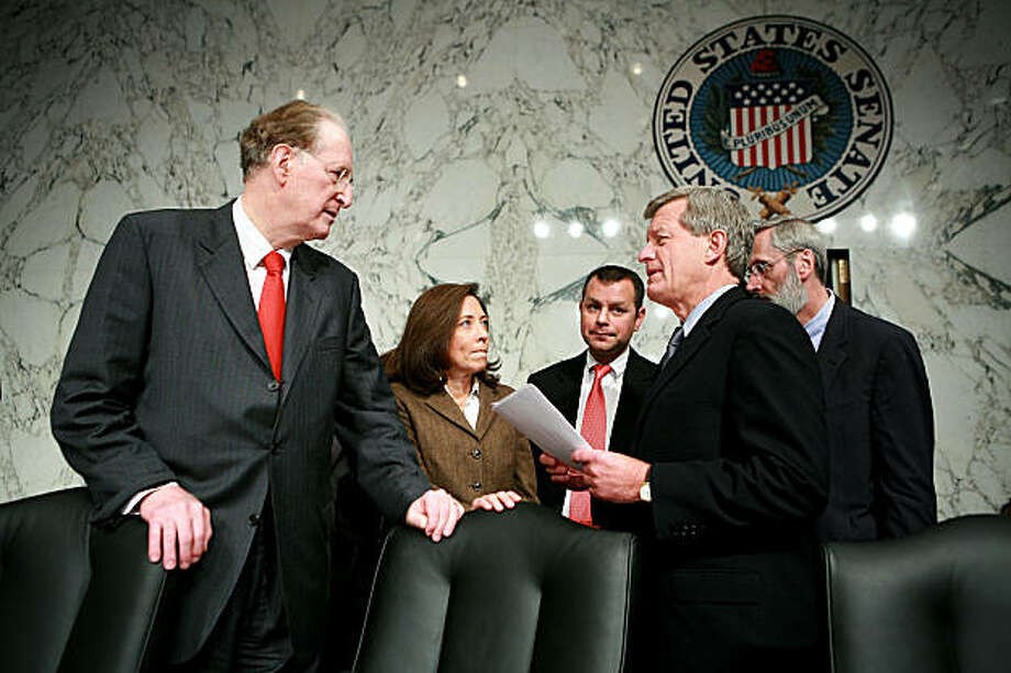 WASHINGTON - OCTOBER 01:  U.S. Senate Finance Committee Chairman Sen. Max Baucus (D-MT) (2nd R) talks to Sen. John Rockefeller (D-WV) (L) and Sen. Maria Cantwell (D-WA) during a break in a hearing on Capitol Hill October 1, 2009 in Washington, DC. The committee continued to vote on amendments to healthcare reform legislation.  (Photo by Alex Wong/Getty Images) Photo: Alex Wong, Getty Images