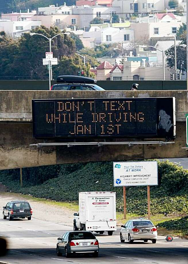 SAN FRANCISCO - DECEMBER 29:  Cars drive by a sign notifying of a new texting while driving law on Interstate 280 December 29, 2008 in San Francisco, California. A new law making it illegal to send text messages while driving will begin on January 1, 2009.  (Photo by Justin Sullivan/Getty Images) Photo: Justin Sullivan, Getty Images