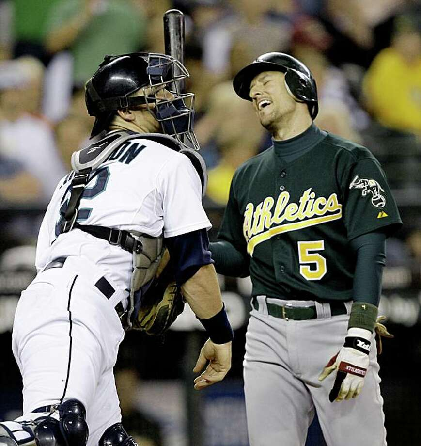 Oakland Athletics' Nomar Garciaparra reacts to being called out looking as Seattle Mariners catcher Rob Johnson returns the ball to the mound in the ninth inning Wednesday, Aug. 26, 2009, during a baseball game in Seattle. The Mariners won 5-3. (AP Photo/Elaine Thompson) Photo: Elaine Thompson, AP