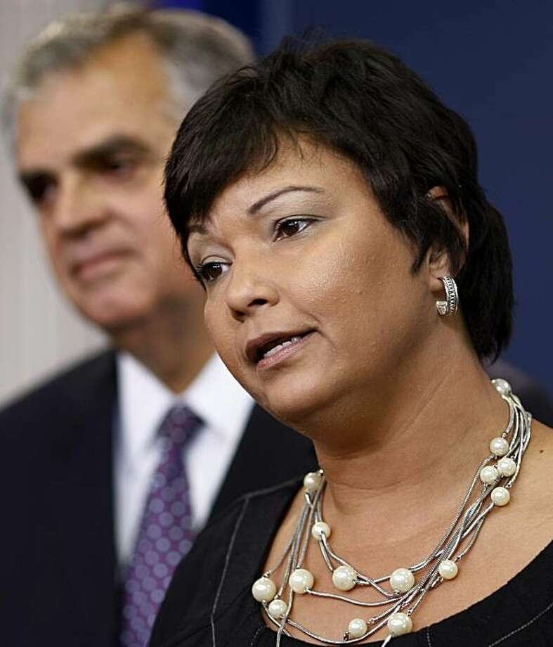 Environmental Protection Agency Administrator Lisa Jackson, right, accompanied by Transportation Secretary Ray LaHood, speaks to reporters in the White House briefing room in Washington, Tuesday, Sept. 15, 2009, about a plan by the Obama Administration to require better gas mileage for new cars and trucks and tougher rules on vehicle greenhouse gas emissions.  (AP Photo/J. Scott Applewhite) Photo: J. Scott Applewhite, AP