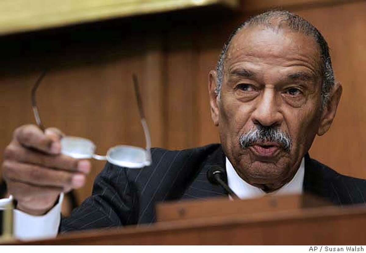 House Judiciary Committee Chairman John Conyers, D-Mich., talks about Paul McNulty, who served as deputy attorney general under Alberto Gonzales and who has announced his resignation, during a hearing of the House Commercial and Administrative Law Subcommittee on Capitol Hill in washington Thursday, June 21, 2007 regarding McNulty's role in the U.S. attorney firings. (AP Photo/Susan Walsh)