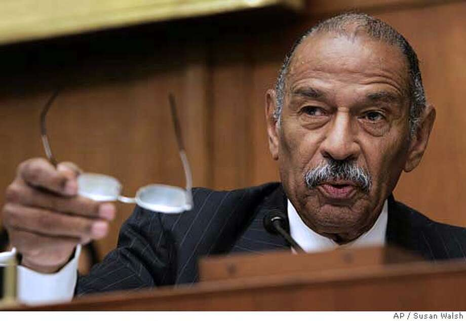 House Judiciary Committee Chairman John Conyers, D-Mich., talks about Paul McNulty, who served as deputy attorney general under Alberto Gonzales and who has announced his resignation, during a hearing of the House Commercial and Administrative Law Subcommittee on Capitol Hill in washington Thursday, June 21, 2007 regarding McNulty's role in the U.S. attorney firings. (AP Photo/Susan Walsh) Photo: Susan Walsh