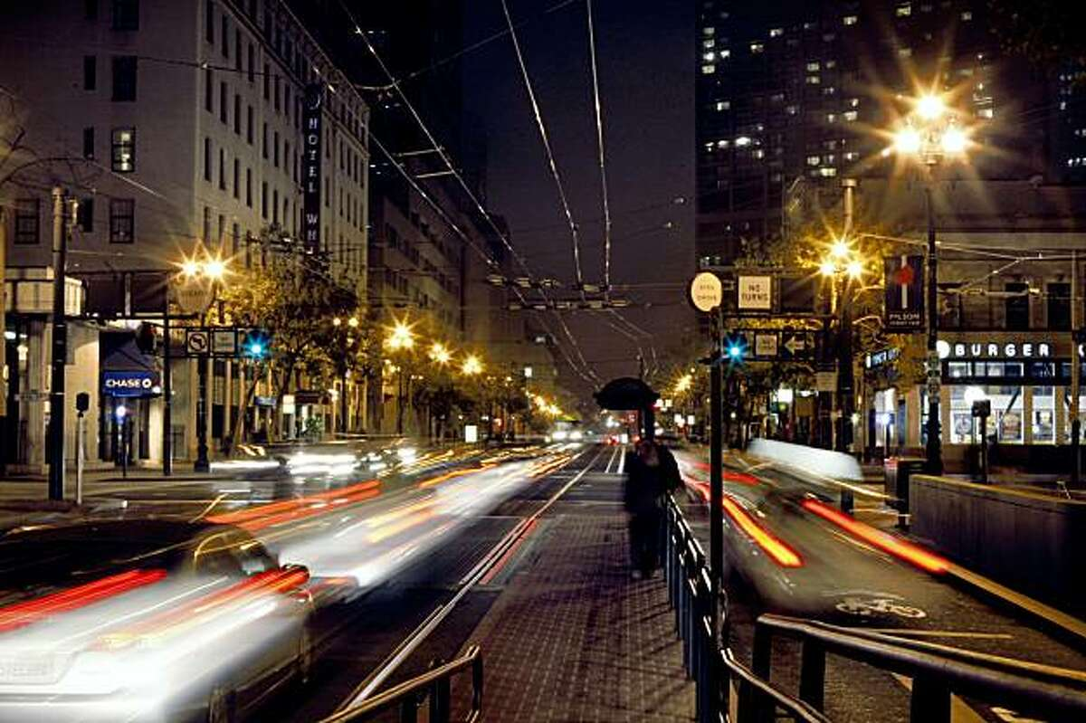 Traffic on Market Street at 8th St. in San Francisco, Calif., on Thursday, September 24, 2009. Starting Sept. 29 the city is launching a six week pilot project that will require cars heading East on Market toward the Ferry Building to turn off at 8th or 6th streets.