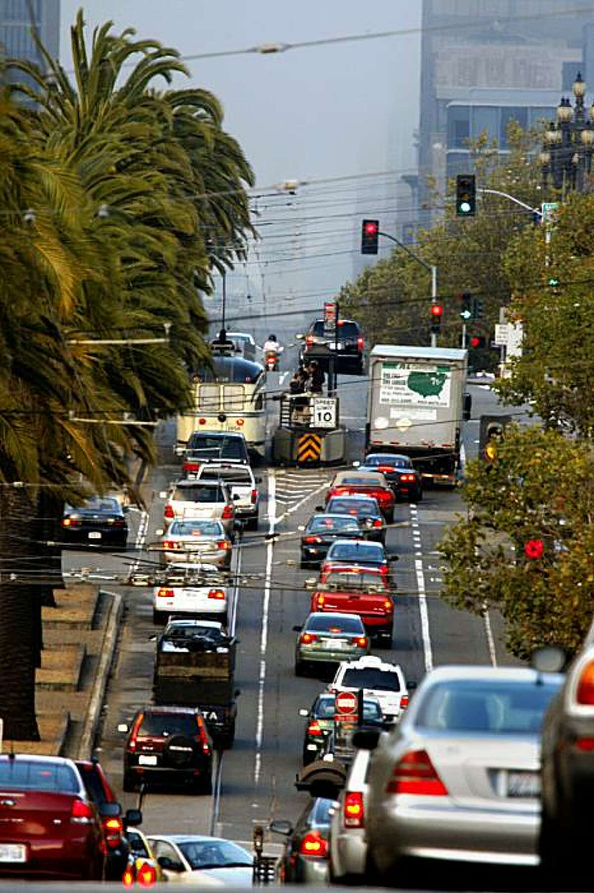 Eastbound traffic on Market Street near 15th St. (outside the range of closures) in San Francisco, Calif., on Thursday, September 24, 2009. Starting Sept. 29 the city is launching a six week pilot project that will require cars heading East on Market toward the Ferry Building to turn off at 8th or 6th streets.