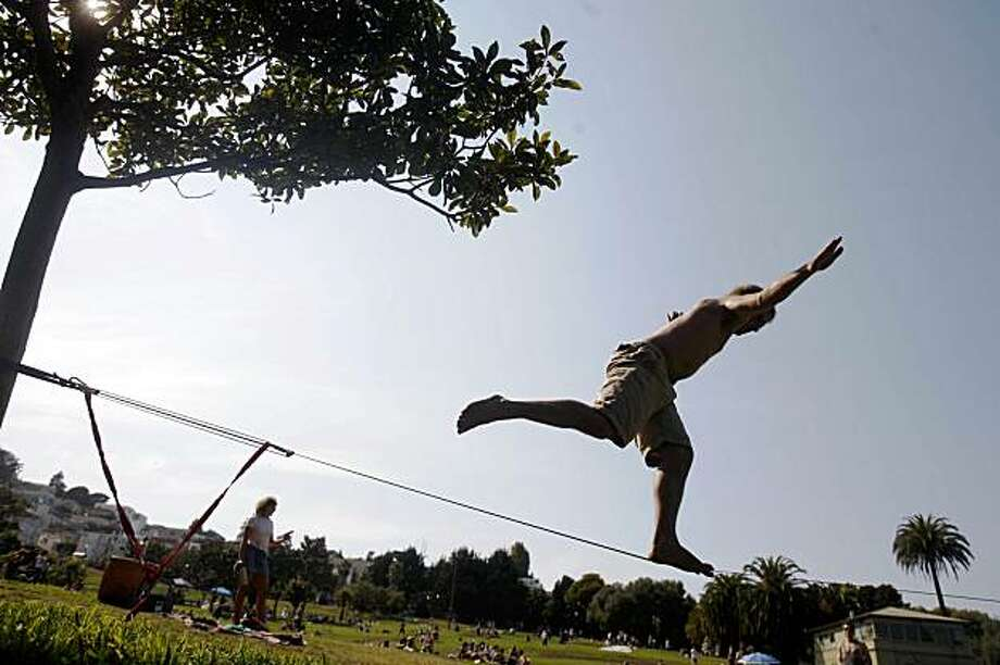 Andrew Fisher keeps his balance on a slack line at Dolores Park in San Francisco, Calif. on Sunday, September 27, 2009. Photo: Lea Suzuki, The Chronicle