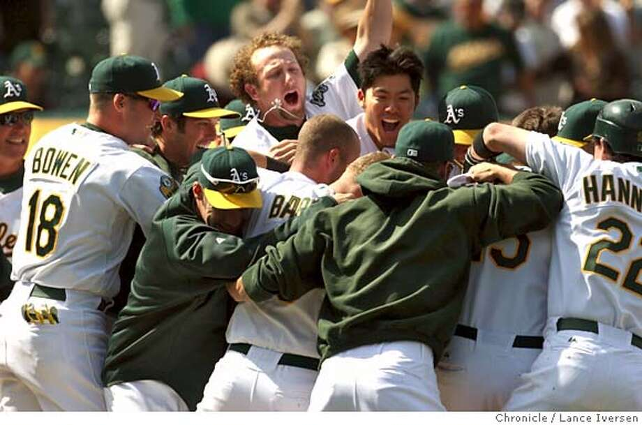 Oakland Athletics' Mark Ellis is congratulated by by the team after Ellis hit a solo home run off Baltimore Orioles pitcher Lance Cormier in the bottom of the 10th inning of their baseball game, Wednesday, May 7, 2008, in Oakland. Photo By Lance Iversen / San Francisco Chronicle. Photo: LANCE IVERSEN
