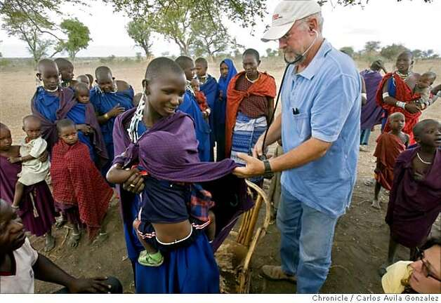 ###Live Caption:Dr. Frank Artress helps a Maasai woman take her baby off her back in her village near Mdori, Tanzania on Thursday, October 31, 2007, as he and his volunteer medical staff treat villagers for free. Dr. Frank Artress, a former cardiac anesthesiologist from Modesto, Calif., survived a nearly fatal climb on Mount Kilimanjaro nearly five years ago. Since then, he and his wife Susan have returned to Tanzania to heal the people of the country they grew to love and call home. Their work is done for free, through a charitable organization Frank and Susan founded.  Photo by Carlos Avila Gonzalez / San Francisco Chronicle###Caption History:Dr. Frank Artress helps a Maasai woman take her baby off her back in her village near Mdori, Tanzania on Thursday, October 31, 2007, as he and his volunteer medical staff treat villagers for free. Dr. Frank Artress, a former cardiac anesthesiologist from Modesto, Calif., survived a nearly fatal climb on Mount Kilimanjaro nearly five years ago. Since then, he and his wife Susan have returned to Tanzania to heal the people of the country they grew to love and call home. Their work is done for free, through a charitable organization Frank and Susan founded.  Photo by Carlos Avila Gonzalez / San Francisco Chronicle###Notes:Notes, Contacts, Name CQ's here###Special Instructions:MANDATORY CREDIT FOR PHOTOG AND SAN FRANCISCO CHRONICLE/NO SALES-MAGS OUT Photo: Carlos Avila Gonzalez